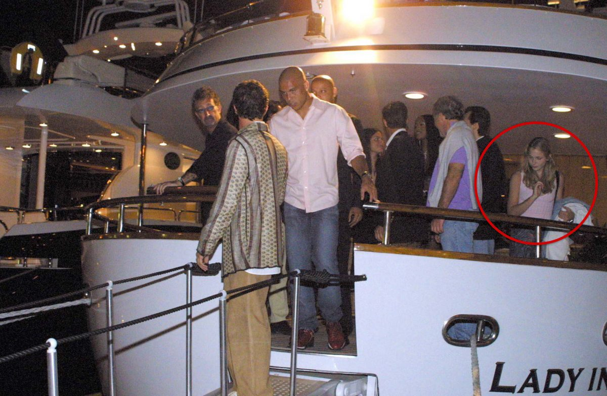 Newly unearthed photos appear to show Virginia Roberts, then aged 17, on board a luxury St Tropez yacht with Jeffrey Epstein, believed to be to the left of her in blue, at Naomi Campbell's birthday party in 2001